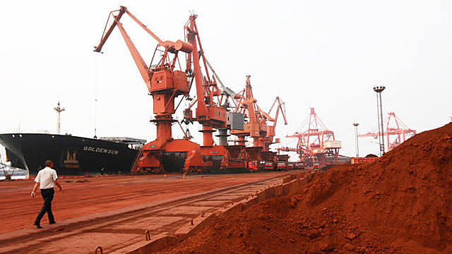 Bulldozers scoop soil rich with rare-earth minerals, destined for Japan, at a Chinese mine site in 2010.   © AFP/Jiji