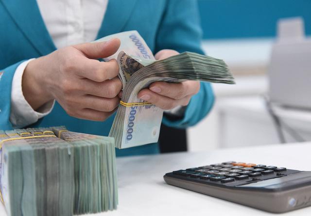 Không khuyến khích nhân viên ngân hàng 'ép' khách mua bảo hiểm