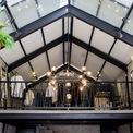 <p> Trên gác lửng là không gian làm thời trang xen kẽ với bàn cà phê để khách hàng có thể vừa thưởng thức cà phê, vừa ngắm nhìn và chọn cho mình một vài bộ quần áo ưng ý.</p>