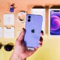 <p> Hình ảnh, logo in trên hộp của iPhone 12 tím trùng với màu máy. Bên trong hộp gồm cáp Lightning, sách hướng dẫn và cây lấy SIM tương tự những chiếc iPhone 12 khác, không có củ sạc và tai nghe. Ảnh: <em>CNET.</em></p>