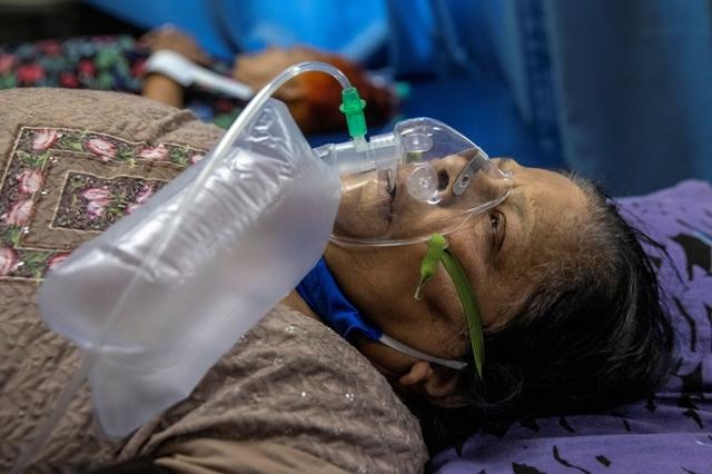 Virus corona đẩy đất nước tỷ dân vào cảnh lao đao. Ảnh: Reuters.