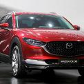 """<p class=""""Normal""""> <strong>Mazda CX-30</strong></p> <p class=""""Normal""""> Hãng xe Nhật Bản giới thiệu CX-30 mới tại Việt Nam. CX-30 nằm giữa cỡ B và C, tương tự Toyota Corolla Cross. Mẫu xe nhà Mazda bán ra hai phiên bản: 2.0 Luxury giá 839 triệu và 2.0 Premium giá 899 triệu. Đối thủ Corolla Cross giá từ 720-820-910 triệu.</p> <p class=""""Normal""""> CX-30 lắp động cơ SkyActiv-G 2.0 công suất 153 mã lực, mô-men xoắn cực đại 200 Nm. Hộp số tự động 6 cấp. Xe sử dụng công nghệ kiểm soát gia tốc GVC Plus và ngắt động cơ tạm thời i-stop. (Ảnh: <em>Đắc Thành</em>)</p>"""