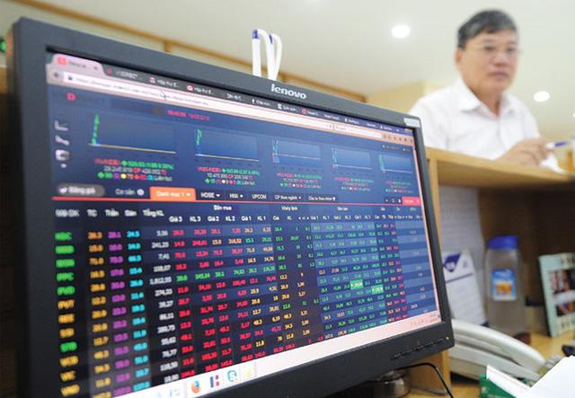 Cổ phiếu ngân hàng tăng giá liên tục do đâu? - Ảnh 1.