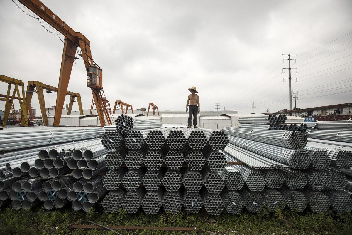 Kinh tế Trung Quốc mất dần đà phục hồi vì giá hàng hóa tăng