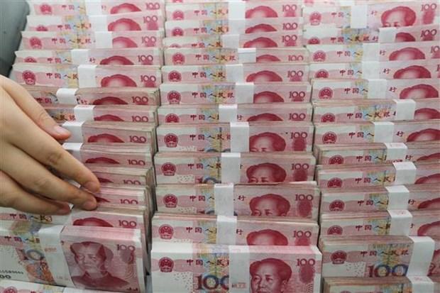 Đồng nhân dân tệ tại một ngân hàng ở Giang Tô, Trung Quốc. (Ảnh: AFP/TTXVN)