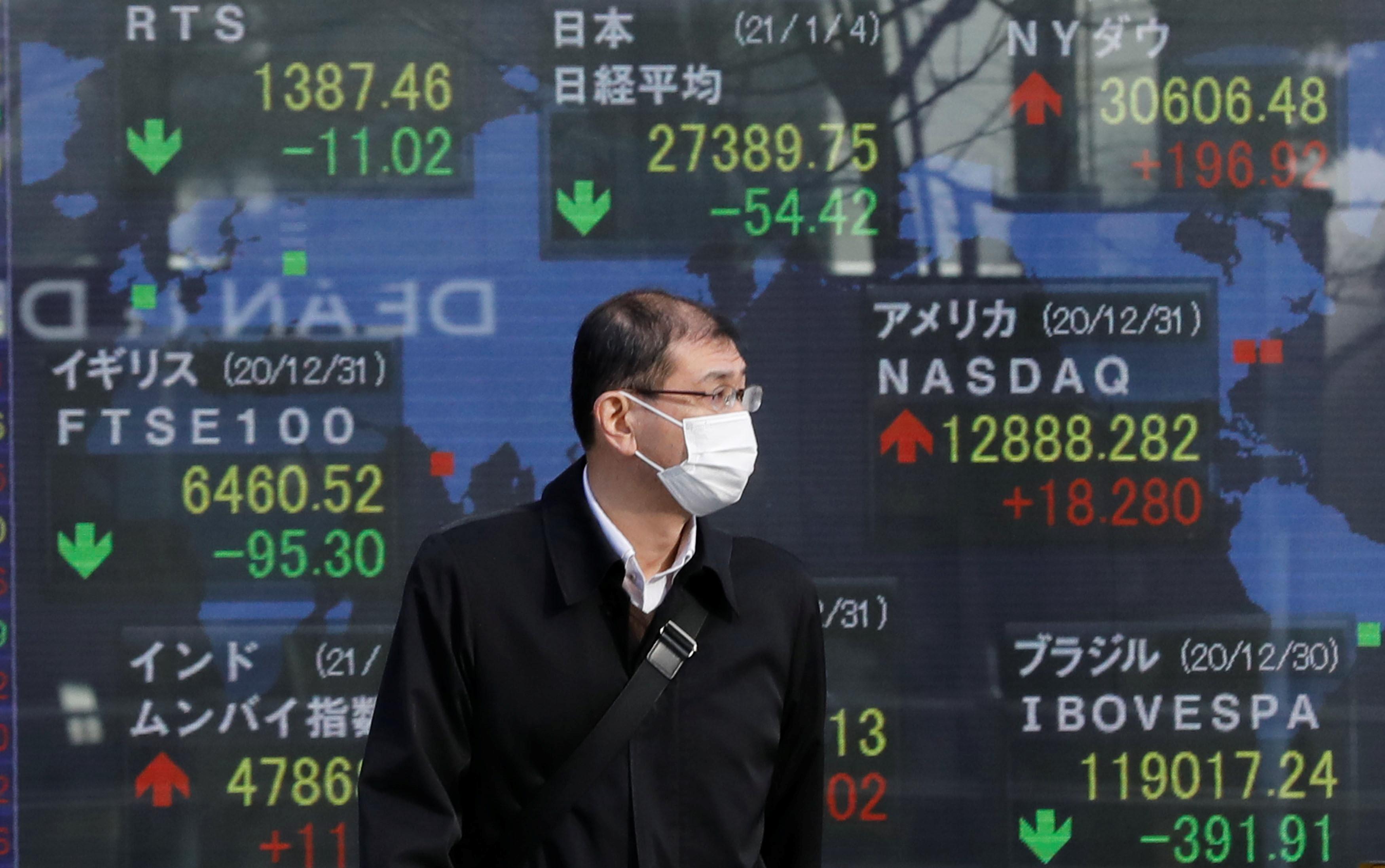 Chứng khoán châu Á trái chiều sau khi Fed họp xong