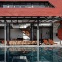 """<p class=""""Normal""""> Căn nhà 3 tầng được xây trên khu đất rộng 7.720 m2 là tổ ấm của một gia đình 4 người ở quận Bình Tân, TP HCM. Tổng diện tích sàn là 460 m2, tầng trệt là không gian sinh hoạt chung, phía trước có bể bơi rộng, tầng 2, 3 gồm phòng ngủ và các không gian riêng tư khác. </p>"""