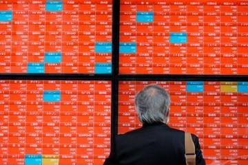 Chứng khoán châu Á giảm, chờ Nhật Bản ra quyết sách tiền tệ