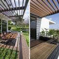 """<p class=""""Normal""""> Ngôi nhà sử dụng tông màu đất nhiệt đới đơn giản nhưng không kém phần hiện đại cùng những vật liệu tự nhiên tạo nên cảm giác nhẹ nhàng tinh tế, góp phần làm nổi bật các mảng xanh của cảnh quan xung quanh.</p>"""