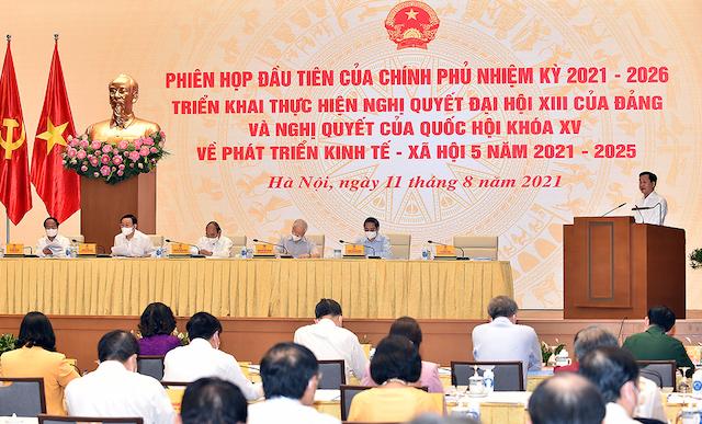 Phó Thủ tướng Chính phủ Lê Minh Khái trình bày Báo cáo về các nhiệm vụ, giải pháp trọng tâm của Chính phủ nhiệm kỳ 2021-2026 triển khai thực hiện Nghị quyết Đại hội XIII của Đảng và Nghị quyết Quốc hội về kế hoạch phát triển kinh tế - xã hội 5 năm 2021-2025