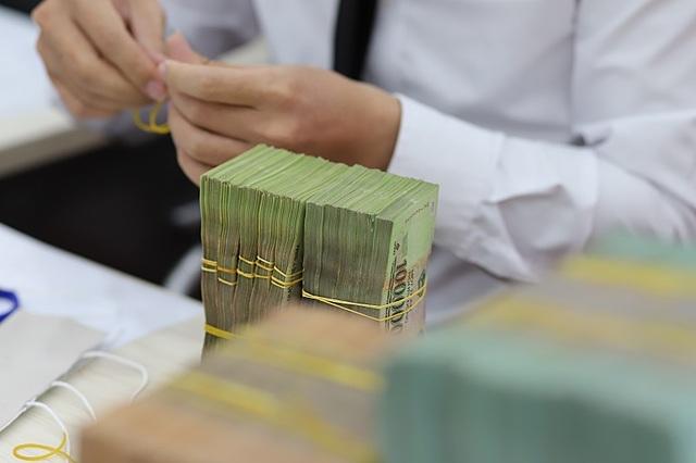 Khoản nợ và lãi ngân hàng trở thành gánh nặng với người vay trong bối cảnh dịch bệnh