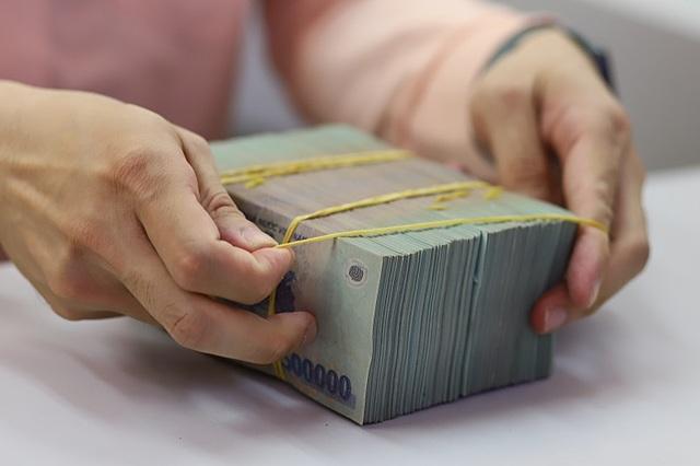 Ngân hàng tăng bao phủ nợ xấu. Ảnh: B.L