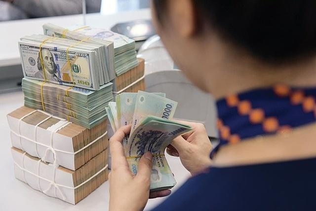Ngân hàng đứng trước áp lực nợ xấu tăng. Ảnh: TBNH