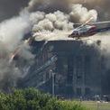 """<p class=""""Normal""""> Hoạt động cứu hộ tại Lầu Năm Góc, nơi hơn 180 người thiệt mạng.</p> <p class=""""Normal""""> Tòa nhà được sửa chữa hoàn toàn trong cùng năm. Ảnh: <em>Reuters</em>.</p>"""