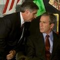 """<p class=""""Normal""""> Tổng thống Mỹ khi đó là George W. Bush lắng nghe khi Chánh văn phòng Nhà Trắng Andrew Caid thông báo về vụ tấn công thứ hai vào WTC. Ông Bush khi đó đang tham gia đọc sách tại trường tiểu học Emma E. Booker ở Sarasota, bang Florida. Ảnh: <em>Reuters</em>.</p>"""