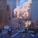 """<p class=""""Normal""""> Mọi người tháo chạy khi Tháp Bắc sụp đổ, tạo ra mây bụi và mảnh vỡ.</p> <p class=""""Normal""""> Một ga tàu điện ngầm dưới WTC cũng bị phá hủy. Ảnh: <em>Reuters</em>.</p>"""