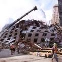 """<p class=""""Normal""""> Các tòa nhà xung quanh khu vực Manhattan cũng chịu thiệt hại nặng, trong đó có tháp 7 của WTC sụp đổ.</p> <p class=""""Normal""""> Trong ảnh là hoạt động cứu hộ, tìm kiếm bên ngoài một tòa nhà sụp đổ ngày 18/9/2001. Ảnh: <em>Getty Images</em>.</p>"""