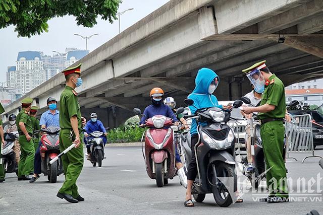 19 quận, huyện ở Hà Nội sẽ không kiểm tra giấy đi đường.