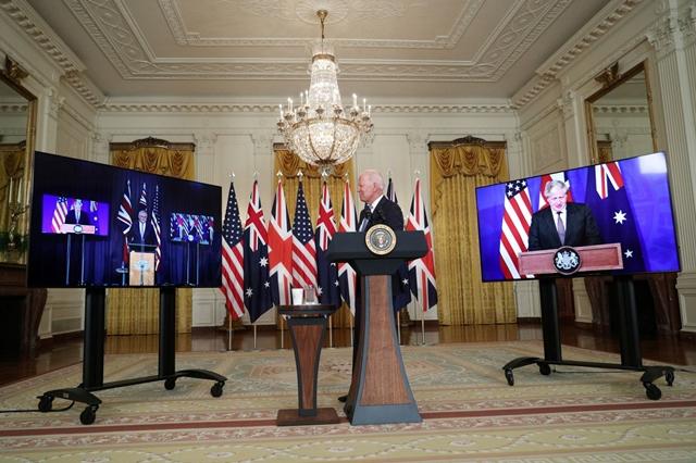 Tổng thống Mỹ Joe Biden, Thủ tướng Australia Scott Morrison và Thủ tướng Anh Boris Johnson tại sự kiện công bố thiết lập thỏa thuận AUKUS. Ảnh: Reuters