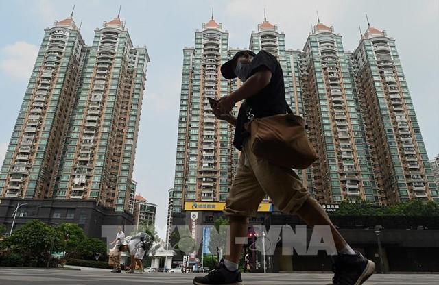 Các tòa nhà do tập đoàn bất động sản Evergrande xây dựng tại Quảng Đông, Trung Quốc, ngày 17/9. Ảnh: AFP/TTXVN