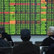 Chứng khoán châu Á giảm, thị trường Trung Quốc có lúc mất hơn 1%