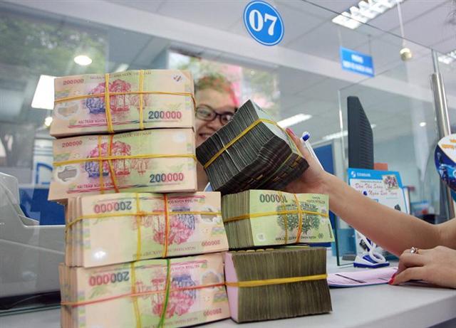 Cần đẩy mạnh tín dụng để doanh nghiệp tiếp cận vốn. Ảnh: VnEconomy.