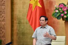 Việt Nam chuyển trạng thái chống Covid-19
