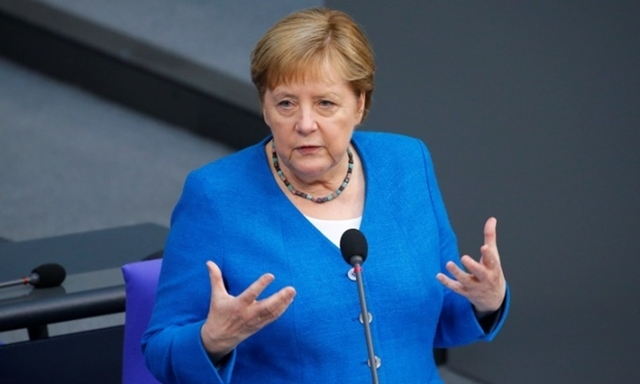 Thủ tướng Đức Angela Merkel phát biểu trước Hạ viện ở Berlin hồi tháng 6. Ảnh: Reuters.