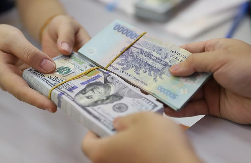 VND lên giá gần 1,5% so với USD sau 9 tháng